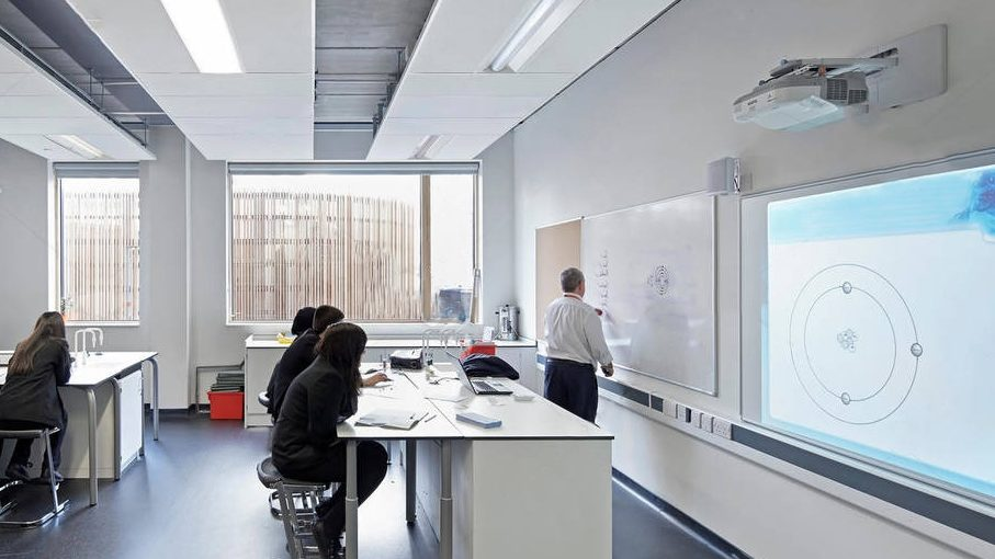 A classroom designed to be light and spacious with desks specialised for science lessons